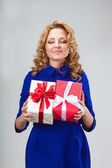 Woman holding two giftboxes — Stock Photo