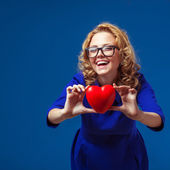 Funny woman holding heart shape — Stock Photo