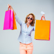 Happy woman with color shopping bags — Stock Photo