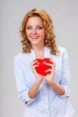 Woman holding red heart symbol — Stock Photo