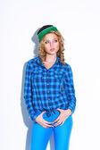 Woman wearing cap standing near wall — Stockfoto