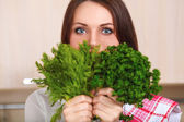 Smiling young housewife mixing fresh salad — Stock Photo