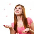 Young woman catching paper hearts — Stock Photo #4642563
