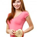 Woman holding heart shape box — Stock Photo #4642701