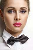 Blondie woman in white shirt and black bow-tie — Stock fotografie