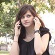 Girl speaking on two mobile phones — Stock Photo #25755585