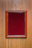 Photoframe on a wooden wall — Stock Photo