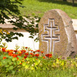 A stone with a cross — Stock Photo