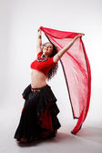 Tribal dancer  with red shawl — Stock Photo
