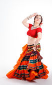 Beautiful brunette tribal dancer — Stock Photo