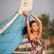 Brunette young girl posing near boat — Stock Photo #50936693