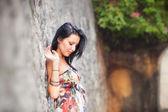Beautiful brunette girl  posing near rock wall — Stock Photo