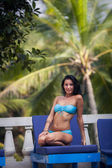 Brunette girl in blue swimming suit — Стоковое фото