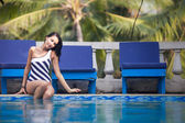 Brunette girl in swimming suit — Stock Photo