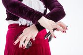Clouse up hands with castanets — Stock Photo