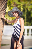 Brunette girl in summer hat — Stock Photo