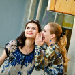 Stock Photo: Two young women talks about shopping