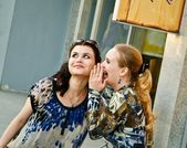 Two young women talks about shopping — Stock Photo