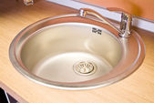 Stainless steel sink on the kitchen — Stock Photo