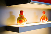 Two decorative bottles on light table on kitchen — Stock Photo