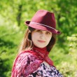 Women in bordo hat on the park — Stock Photo