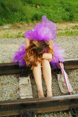 Beauty girl sitting on the rail — Stock Photo
