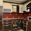 Interior of modern kitchen in dark tones — Stock Photo