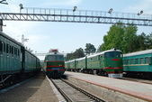 Railway station with retro trains and locomotives — Stock Photo