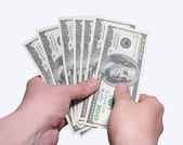 Money dollars is recalculated in hands isolated white background — Stock Photo