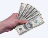 Money dollars in a hand isolated white background — Stock Photo