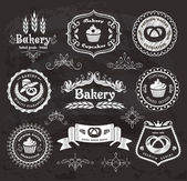Set of vintage retro bakery labels on the chalkboard. — Stock Vector