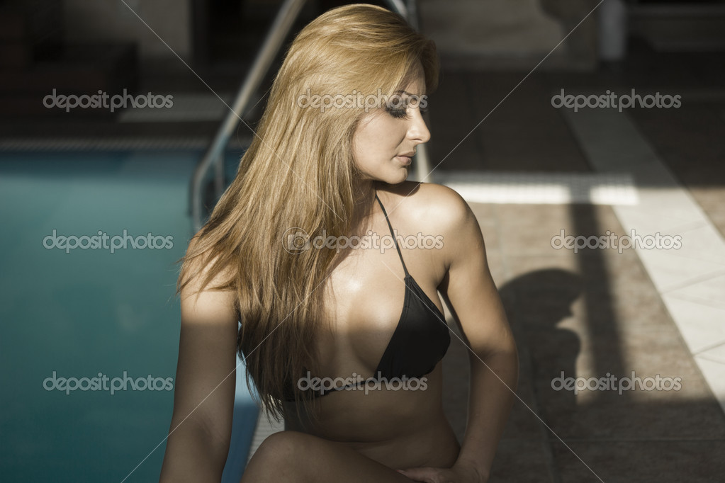 depositphotos 12011861 Sexy indian woman in black bikini by a pool Sexy indian woman in black bikini by a pool
