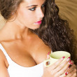 Beautiful woman in the bed with coffee — Stock Photo