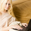 Beautiful blonde woman with laptop computer — Stock Photo #14615777