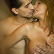Sexy topless passion couple in the bedroom — Stock Photo