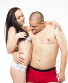 Sexy passionate straight couple on white isolated background — Stock Photo