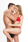 Sexy young passion couple on white isolated background — Stock Photo