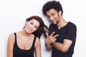 Young cheerful interracial couple on white isolated background — Stock Photo