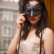 Sexy lingerie woman in venetian mask in a vintage room — Stock Photo #35675811