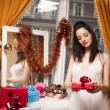 Beautiful vintage woman with present boxes — Stock Photo
