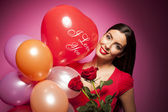 Beautiful woman with valentines day decorations on pink background — Stock Photo