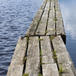 Wooden path floating on calm water — Stock Photo