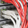 Stock Photo: Network switch and cables
