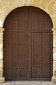 Oval Wooden Doors With Iron Fittings — Stock Photo