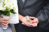 The lock in hands of newlyweds — Stock Photo