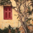 Window with red shutter of Anafiotika in town of Athens,Greece. — Stock Photo #31947709