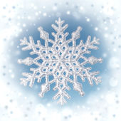 Winter background,snowflake on real blue sky background — Stock Photo