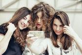 Three funny pretty girls make self photo — ストック写真