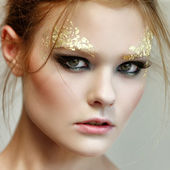 Fashion woman - beauty gilded golden make-up — Stock Photo