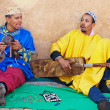 Two Moroccan street musician playing on the street — Stock Photo #40146599